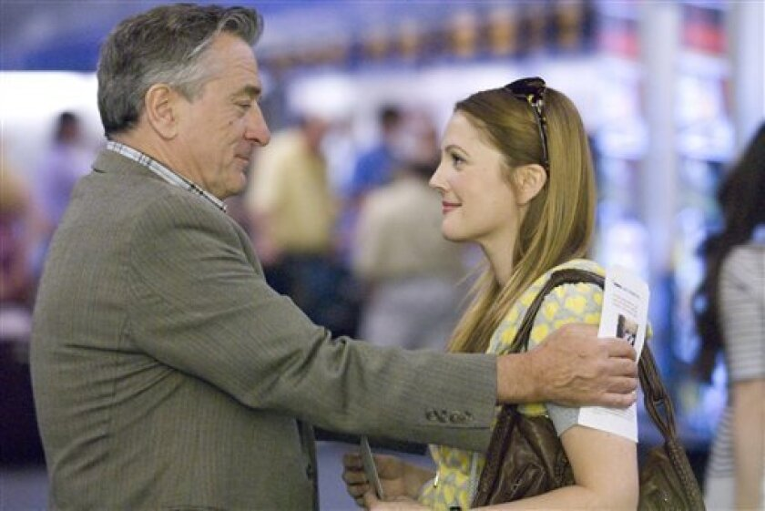 """In this film publicity image released by Miramax Film Corp., Robert De Niro, left, and Drew Barrymore are shown in a scene from """"Everybody's Fine."""" (AP Photo/Miramax Film Corp., Abbot Genser)"""