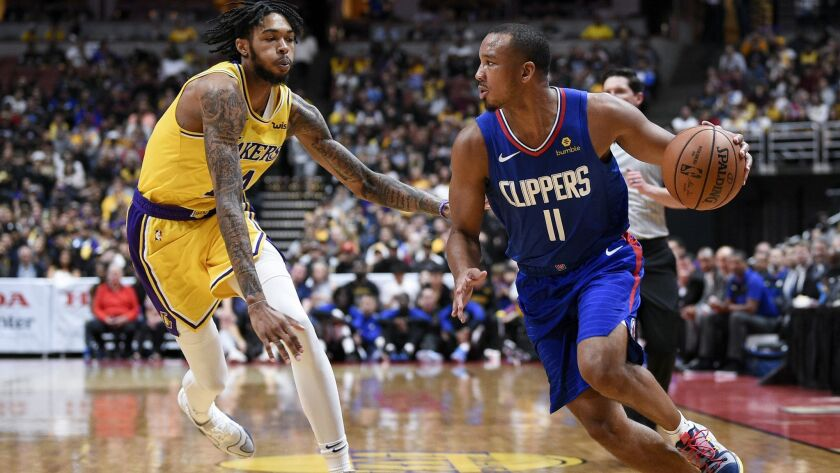 Los Angeles Clippers guard Avery Bradley, right, handles the ball as Los Angeles Lakers forward Bran