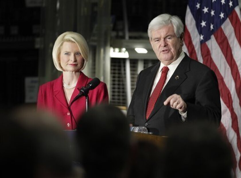 With his wife Callista at left, Republican presidential candidate, former House Speaker Newt Gingrich speaks after touring the Jergens manufacturing facility in Cleveland during a campaign stop on Wednesday, Feb. 8, 2012. Gingrich, suddenly in danger of losing his perch as Mitt Romney's strongest GOP challenger, is fine-tuning his presidential campaign. He's placing more emphasis on raising money, guarding his home turf and trying to avoid nasty quarrels with the front-runner. (AP Photo/Amy Sancetta)
