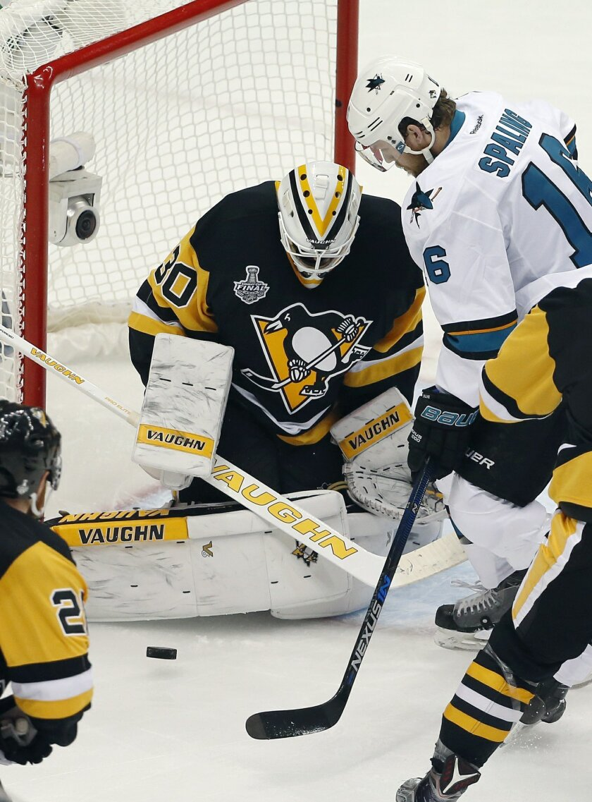 Pittsburgh Penguins goalie Matt Murray (30) defends against San Jose Sharks' Nick Spaling (16) during the first period in Game 2 of the NHL hockey Stanley Cup finals on Wednesday, June 1, 2016, in Pittsburgh. (AP Photo/Gene J. Puskar)