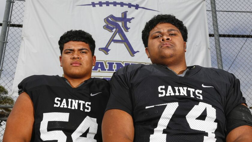 The line play of senior Walter Pongia (54) and sophomore brother Tangitangi Pongia (74) has helped vault the Saints to a No. 6 ranking.