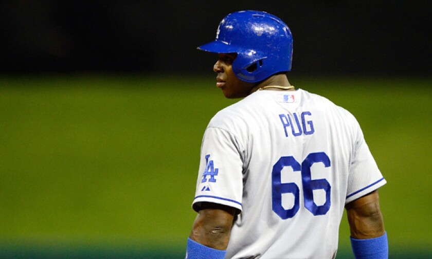 Rookie outfielder Yasiel Puig was scheduled to be out of the starting lineup for Tuesday's game against the Miami Marlins before he was issued a fine by the Dodgers, Manager Don Mattingly said.