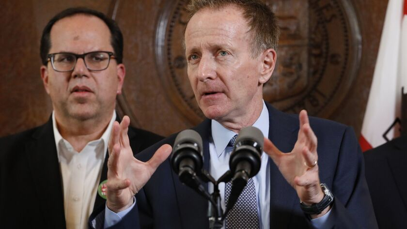 L.A. Unified Supt. Austin Beutner, right, with United Teachers Los Angeles President Alex Caputo-Pearl, left, during a press conference at city hall on January 22.