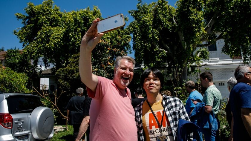 DOWNEY, CALIF. -- THURSDAY, APRIL 25, 2019: K. Jeffrey De Hart, left, snaps selfies with fellow Carp