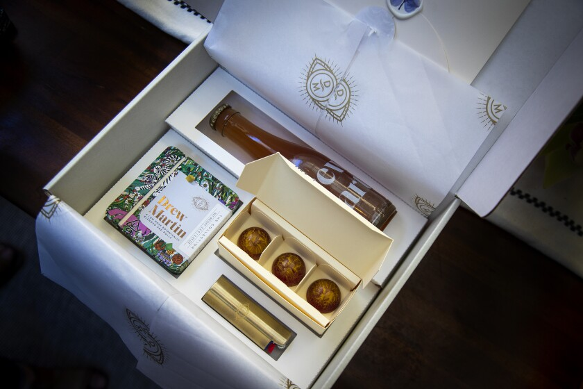 A box from cannabis brand Drew Martin contains a bottle, some chocolate and a pack of pre-rolled joints.
