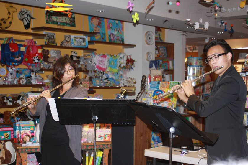 Flutists Elena Yarritu and Carlos Aguilar (first-place winner in La Jolla Symphony & Chorus's Young Artists Competition) perform during the event.