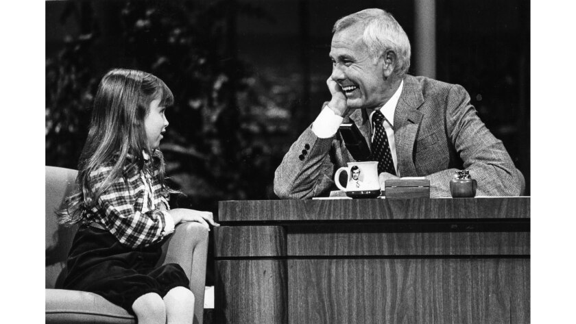 """Sept. 15, 1982: During a taping of """"The Tonight Show,"""" Johnny Carson gets a laugh with 7-year-old actress Kaleena Kiff."""