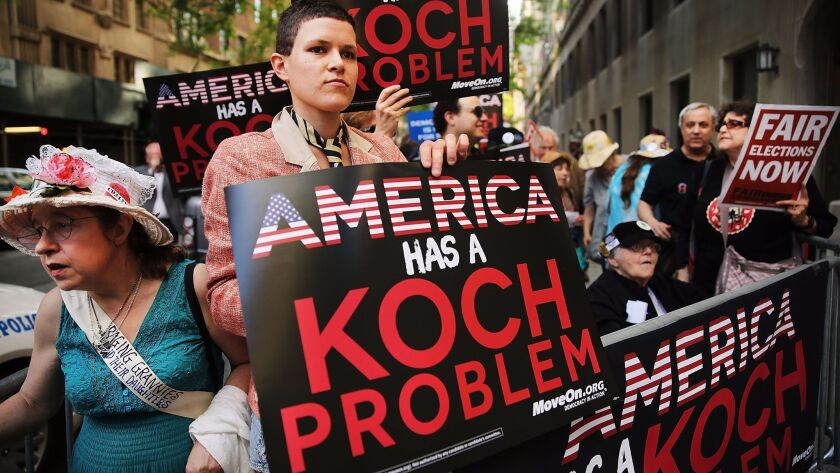 Activists hold a protest near the Manhattan apartment of David Koch on June 5, 2014 in New York City