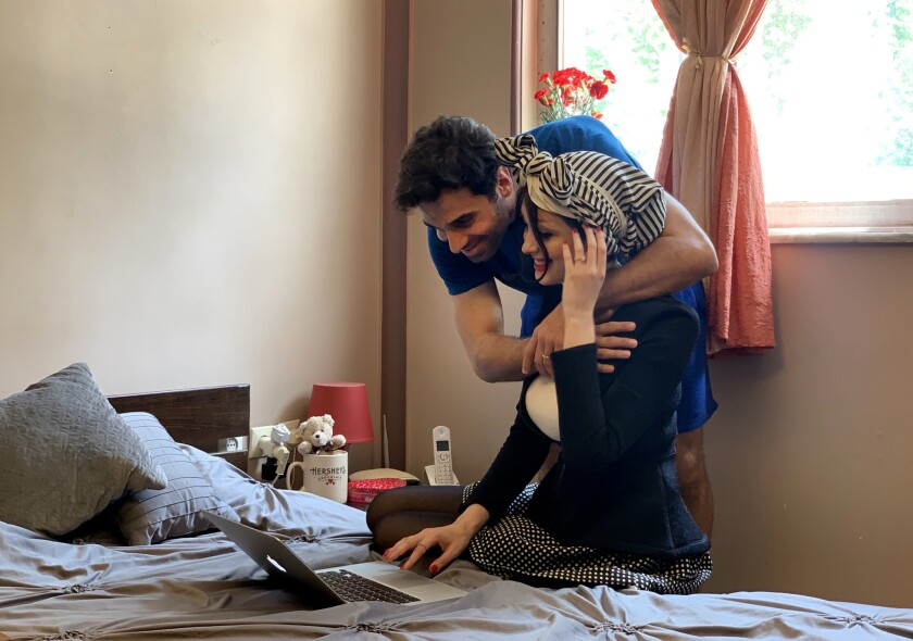 Amin Sirati hugs his wife Shamim Darchini. The years apart have been difficult for the couple. Darch