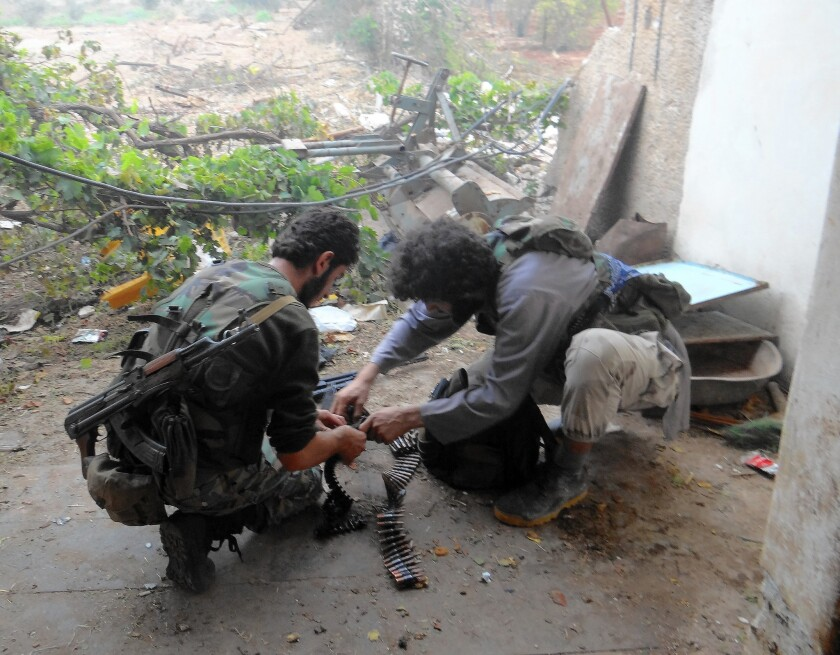 Rebel fighters in Handarat, Syria, in October 2014. Al Nusra Front, Al Qaeda's official franchise in Syria, has defeated the U.S.-backed Harakat Hazm rebel faction and taken the group's American weapons.