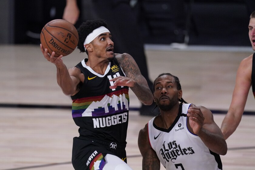 Nuggets guard Gary Harris tries to score against Clippers forward Kawhi Leonard during the second half of Game 4.