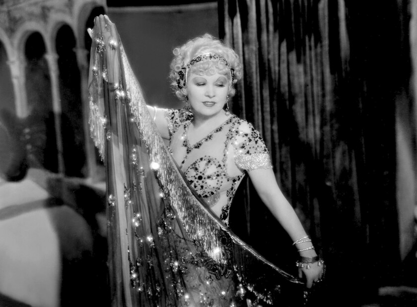 """This image released by PBS shows Mae West in a scene from the 1933 film """"I'm No Angel."""" """"Mae West: Dirty Blonde,"""" the first major documentary film on this cultural figure, makes its world premiere Tuesday on PBS, an attempt to look beyond West's gowns, curves and jewels. (Alamy/PBS via AP)"""