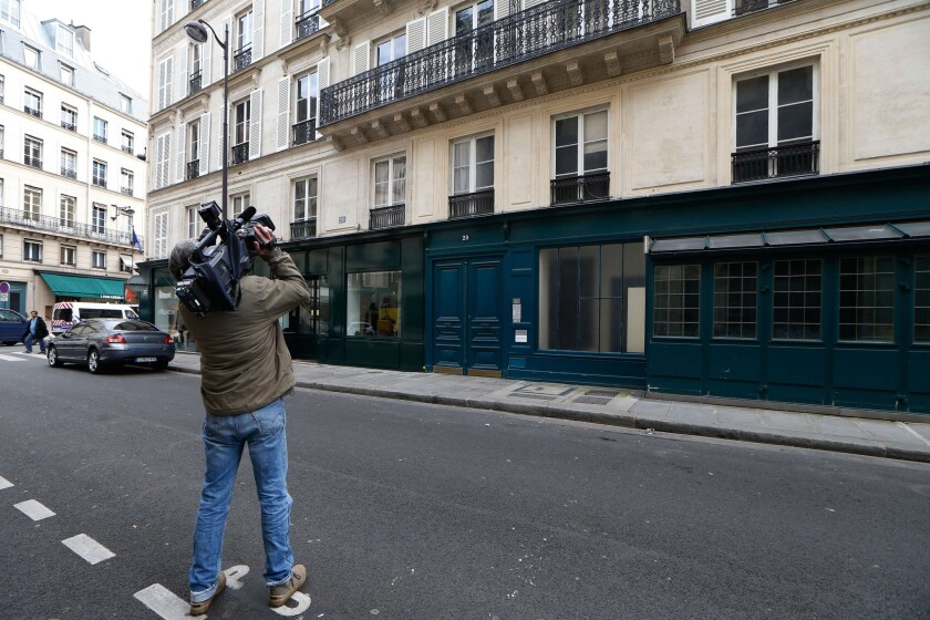A photographer on Monday shoots video of the building where French President Francois Hollande allegedly met with French actress Julie Gayet, located at 20 Rue du Cirque, near the Elysee Palace in Paris.