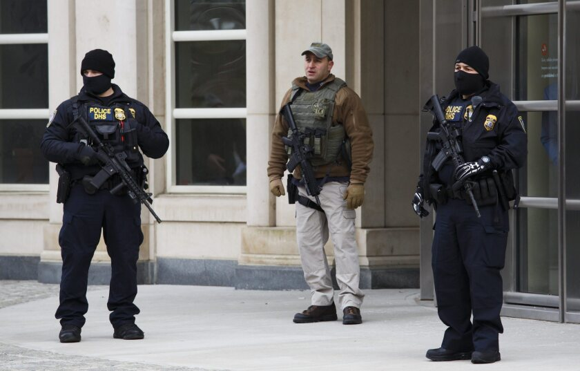 """Armed officers outside the federal courthouse in Brooklyn are among the extra security precautions in place for the legal proceedings against Joaquin """"El Chapo"""" Guzman."""