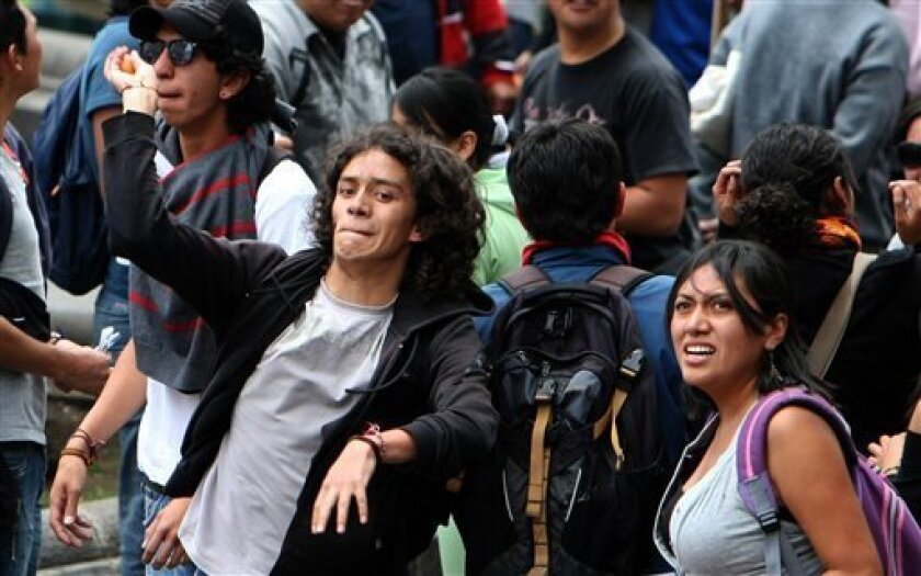 University students throw eggs against the facade of the government palace during a protest in Quito, Ecuador, Tuesday, Sept. 28, 2010. Students protested against an education bill proposed by Ecuador's President Rafael Correa. (AP Photo/Dolores Ochoa)