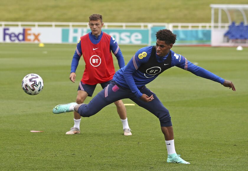 England's Marcus Rashford stretches for a ball during the training session at St George's Park, Burton upon Trent, England on Thursday June 10, 2021. England play their first match at the Euro 2020 soccer championship against Croatia at Wembley stadium in London on June 13. (Nick Potts/PA via AP)
