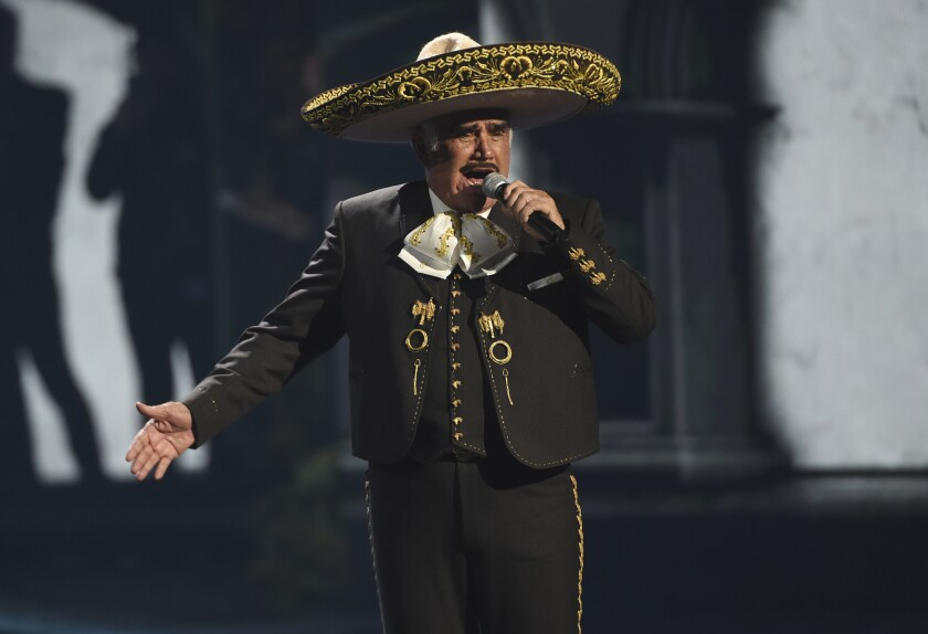 FILE - Vicente Fernandez performs a medley at the 20th Latin Grammy Awards on Nov. 14, 2019, in Las Vegas. The 81-year-old king of ranchera music is in critical but stable condition after being hospitalized for a fall last week, according to an Instagram post made by his medical team on Wednesday, Aug. 11, 2021. (AP Photo/Chris Pizzello, File)