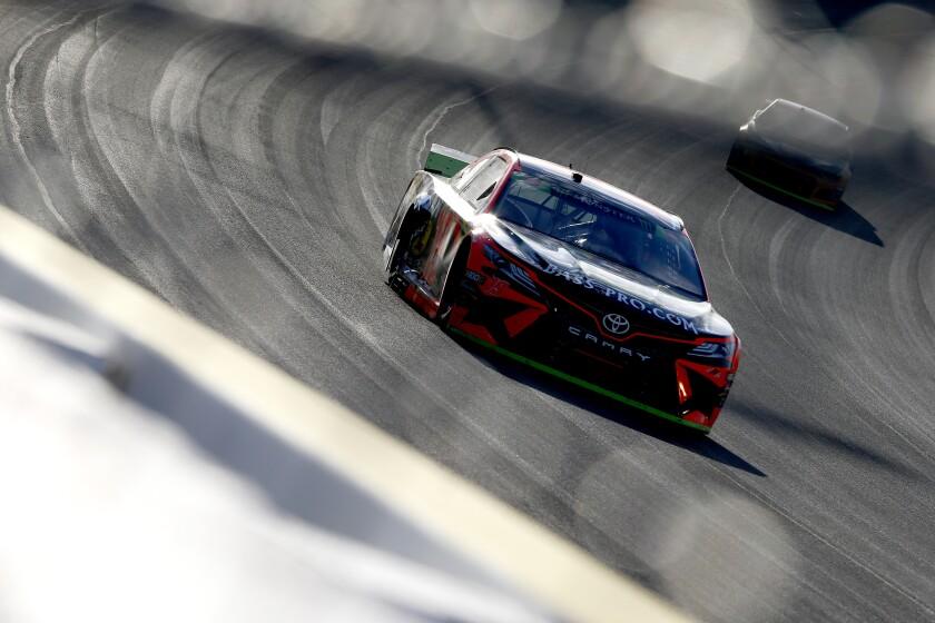 Martin Truex Jr. races at Las Vegas Motor Speedway on Sunday.