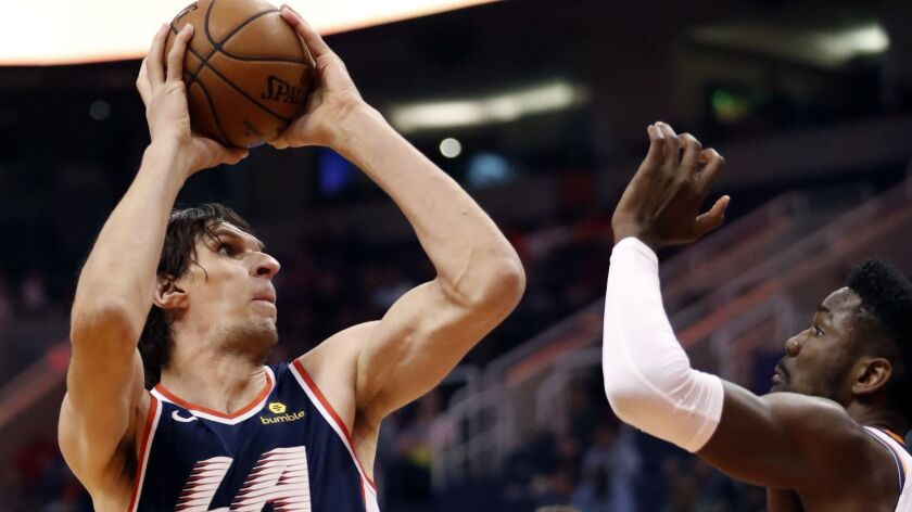 LA Clippers center Boban Marjanovic (51) shoots over Phoenix Suns center Deandre Ayton during the fi