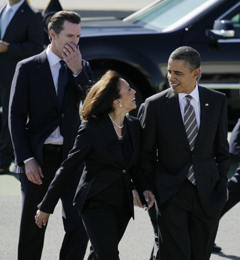 """President Obama arrives at San Francisco International Airport and is greeted by California Atty. Gen. Kamala Harris and Lt. Gov. Gavin Newsom. The president was at an Atherton fundraiser when he joked about Harris as the nation's """"best-looking"""" attorney general."""