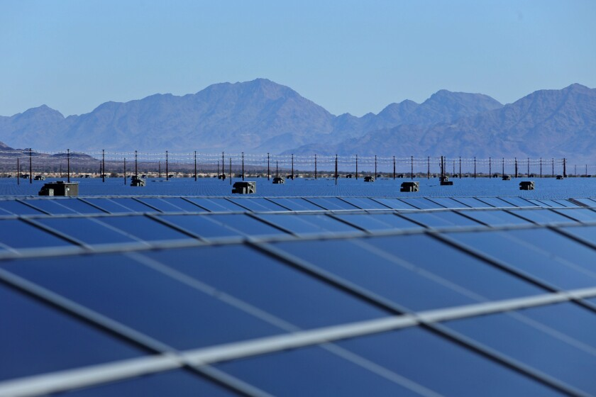 Photo-voltaic solar cells soak in the afternoon sun at the new 550-megawatt Desert Sunlight Solar Farm, in Desert Center, Calif. The project is one of the world's largest photo-voltaic solar farms on 3,800 acres of federal land in Riverside County.