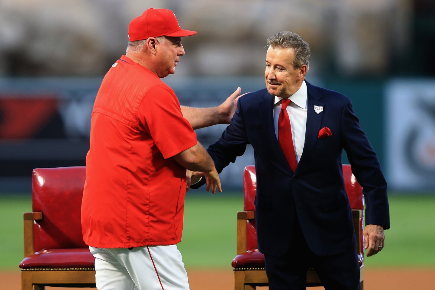 ANAHEIM, CA - AUGUST 10: Manager Mike Scioscia shakes hands with Owner of the Los Angeles Angels of Anaheim Arte Moreno during a ceremony celebrating the induction of Vladimir Guerrero into the Baseball Hall of Fame prior to a game between the Los Angeles Angels of Anaheim and the Oakland Athletics at Angel Stadium on August 10, 2018 in Anaheim, California. (Photo by Sean M. Haffey/Getty Images) ** OUTS - ELSENT, FPG, CM - OUTS * NM, PH, VA if sourced by CT, LA or MoD **