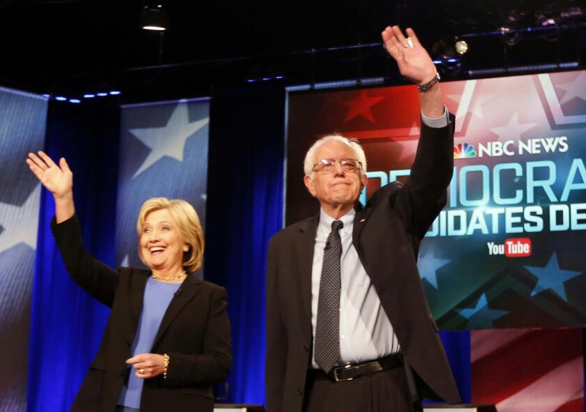 FILE - In this Jan. 17, 2016 photo, Democratic presidential candidates, Hillary Clinton and Sen. Bernie Sanders, I-Vt,  stand together before the start of the NBC, YouTube Democratic presidential debate at the Gaillard Center in Charleston, S.C.  The Democratic presidential campaigns of Hillary Cli