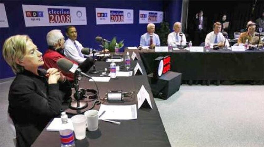 '08 hopefuls, from left, Sen. Hillary Rodham Clinton, D-N.Y., former Alaska Sen. Mike Gravel, Sen. Barack Obama, D-Ill., Sen. Chris Dodd, D-Conn., Sen. Joe Biden, D-Del., former North Carolina Sen. John Edwards, and Rep. Dennis Kucinich, D-Ohio, wait for the start of the National Public Radio debate.
