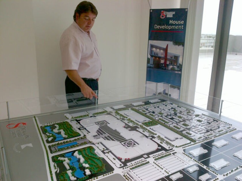 Juan Carlos Lopez, executive director of the Dragon Mart project, looks at a model of the proposed retail center in May 2013.