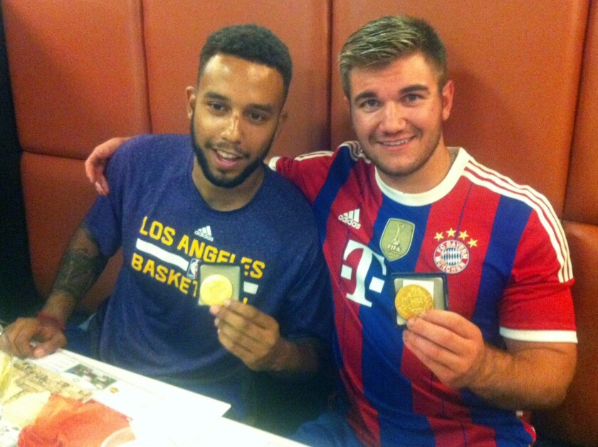 Anthony Sadler, left, and Alek Skarlatos were awarded medals during a brief ceremony in the town of Arras, in northern France, on Friday.