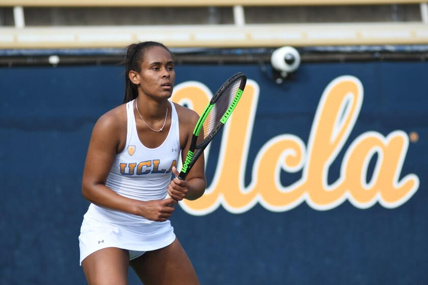 UCLA tennis player Abbey Forbes plays during a match.