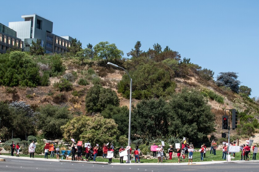 Doctors, nurses and other supporters protest on Wednesday at Palomar Medical Center in Escondido.