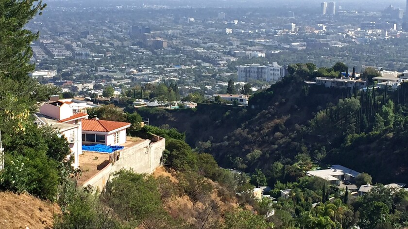 BEFORE: The view home at 1665 Haslam Terrace, Los Angeles, left, was once owned by actress Alexandra Wentworth.