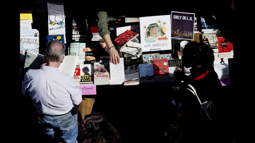 People browse books for sale at the Los Angeles Times Festival of Books at USC.