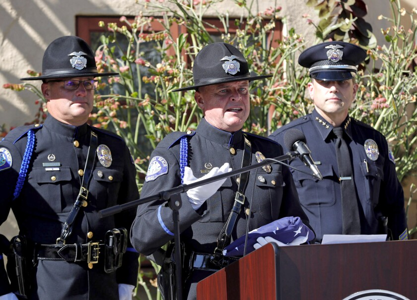 Sgt.  David McGill, center, is honored for his exemplary service on the Laguna Beach Honor Guard.