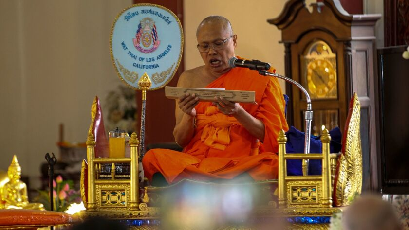 Buddhist priest Pra Kyu Vinai Thorn Kittisak, flown in from Thailand, performs 100-day death anniversary services at Wat Thai Temple in North Hollywood.