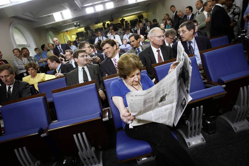 Veteran White House correspondent Helen Thomas, center, from Hearst Newspapers, sits in her assigned center, front-row seat before the ribbon-cutting ceremony for the renovated James S. Brady Press Briefing Room at the White House in Washington. Thomas covered 10 presidents.