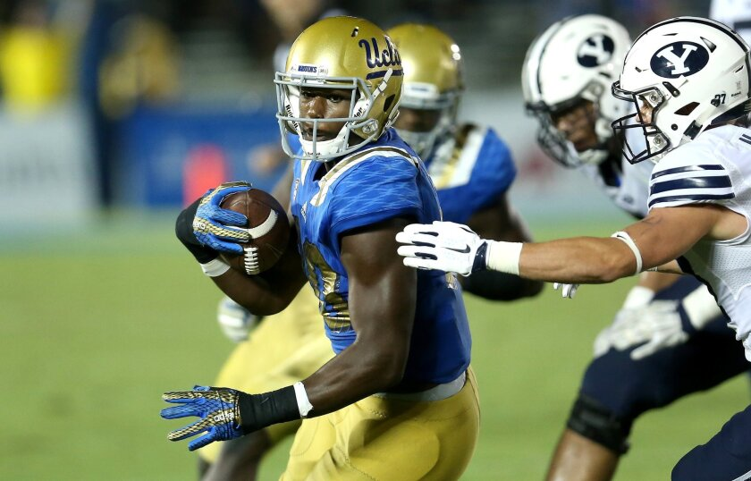 UCLA linebacker Myles Jack runs with the ball after an interception against BYU on Sept. 19.