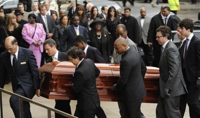 Pallbearers carry the casket of film critic Roger Ebert before his funeral at Holy Name Cathedral in Chicago, Monday, April 8, 2013. Ebert died Thursday, April 4, 2013, at age 70 after a long battle with cancer. (AP Photo/Paul Beaty)