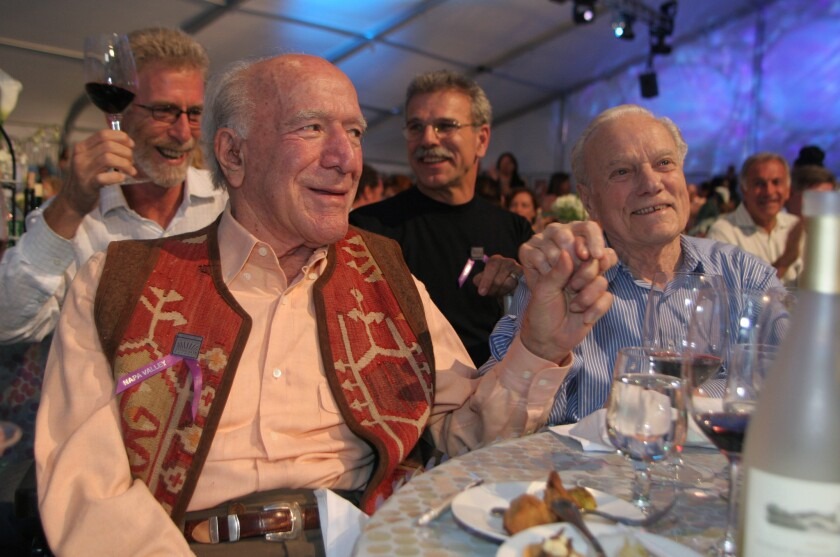 Wine makers Peter Mondavi, right, and his brother Robert Mondavi hold hands at the 26th annual Auction Napa Valley at Meadowwood Resort on June 3, 2006, in St. Helena, Calif. Peter Mondavi died at the age of 101 on Feb. 20.