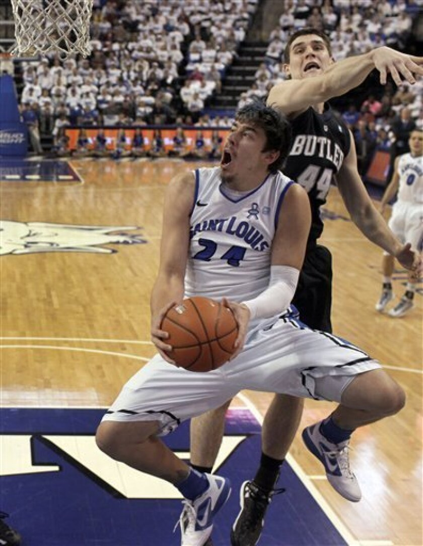 Saint Louis' Cody Ellis (24) heads to the basket as Butler's Andrew Smith defends during the first half of an NCAA college basketball game Thursday, Jan. 31, 2013, in St. Louis. (AP Photo/Jeff Roberson)