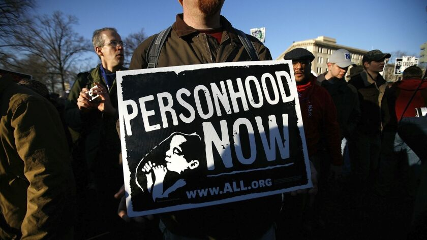 An antiabortion activist holds a sign as he participates in the annual March for Life event in Washington on Jan. 22, 2009.