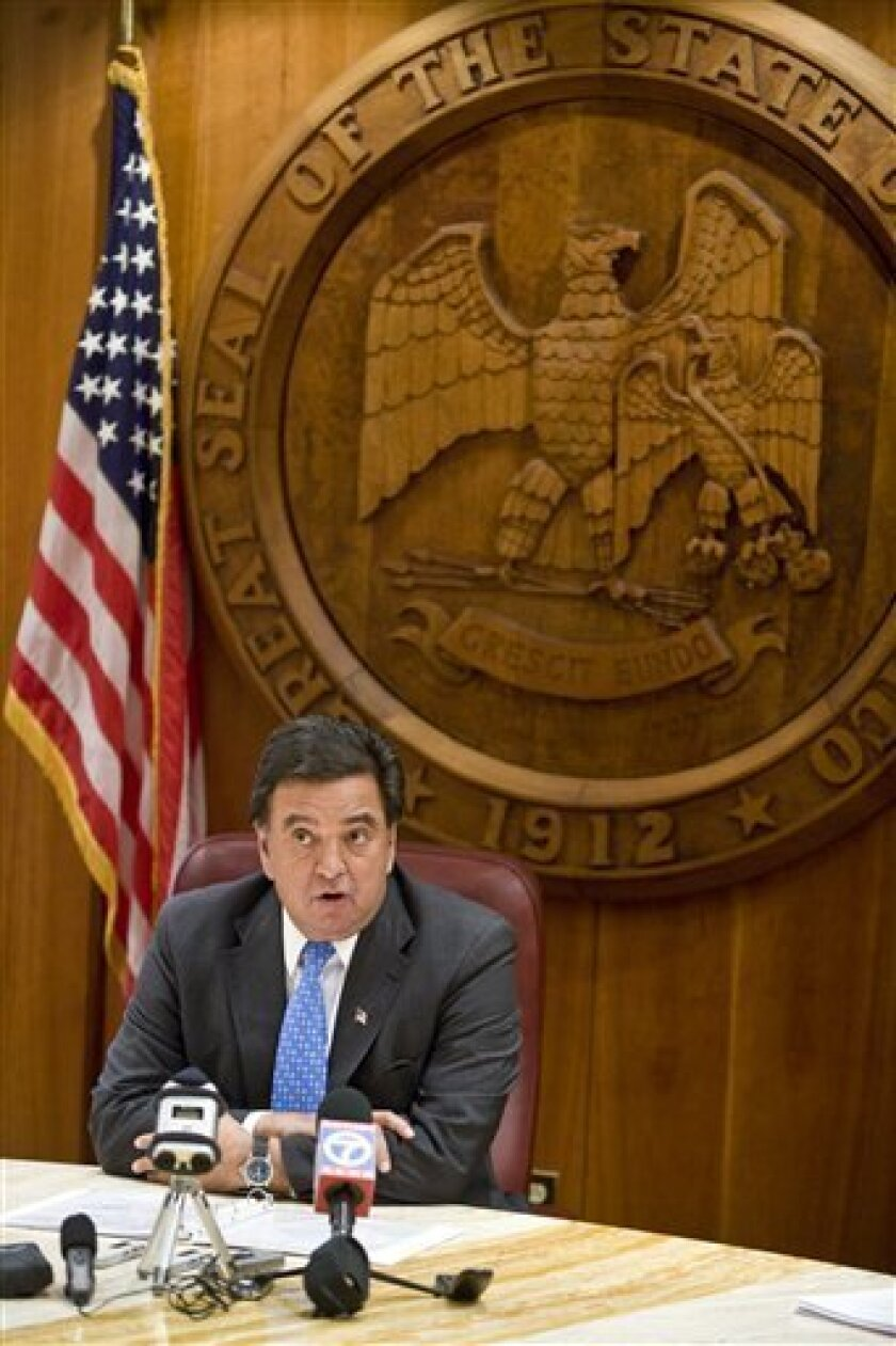 FILE - In this Jan. 5, 2009 file photo, New Mexico Gov. Bill Richardson speaks during a news conference in Santa Fe, N.M. after withdrawing his nomination as U.S. Commerce Department secretary. Richardson and former high-ranking members of his administration won't be criminally charged in a yearlon