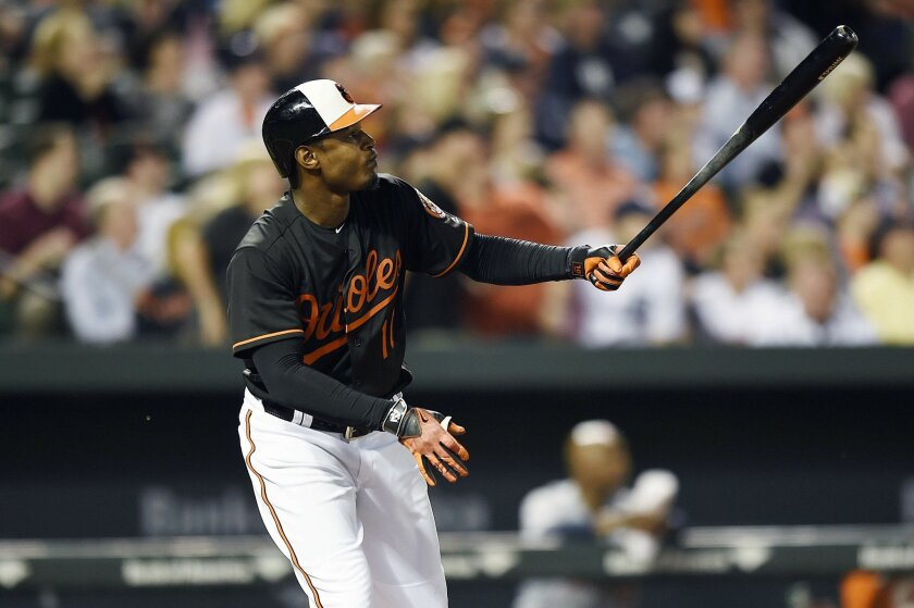 Baltimore Orioles' Adam Jones watches his solo home run leave the ball park against the Detroit Tigers in the seventh inning of a baseball game, Friday, May 13, 2016, in Baltimore. The Orioles won 1-0. (AP Photo/Gail Burton)