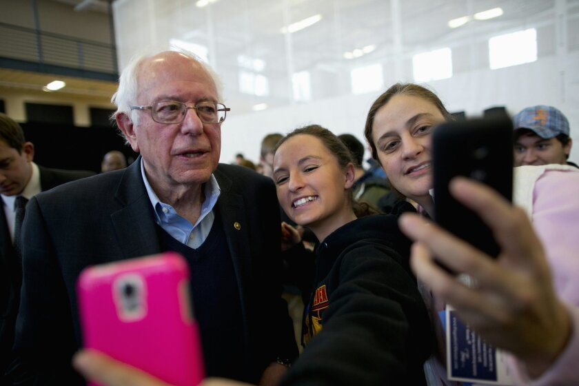 Democratic presidential candidate, Sen. Bernie Sanders, I-Vt. takes a selfie with young supporters at a campaign event, Monday, Jan. 25, 2016, in Iowa Falls, Iowa. (AP Photo/Jae C. Hong)