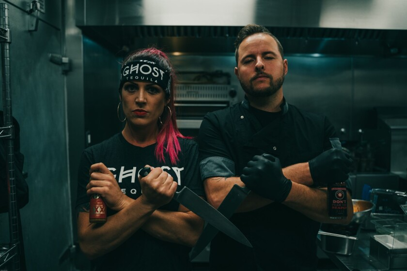 Vegan Danielle, left, and Grant Plummer are two of three partners of Good Distribution. Danielle will host the event and Grant Plummer will be preparing the wings.