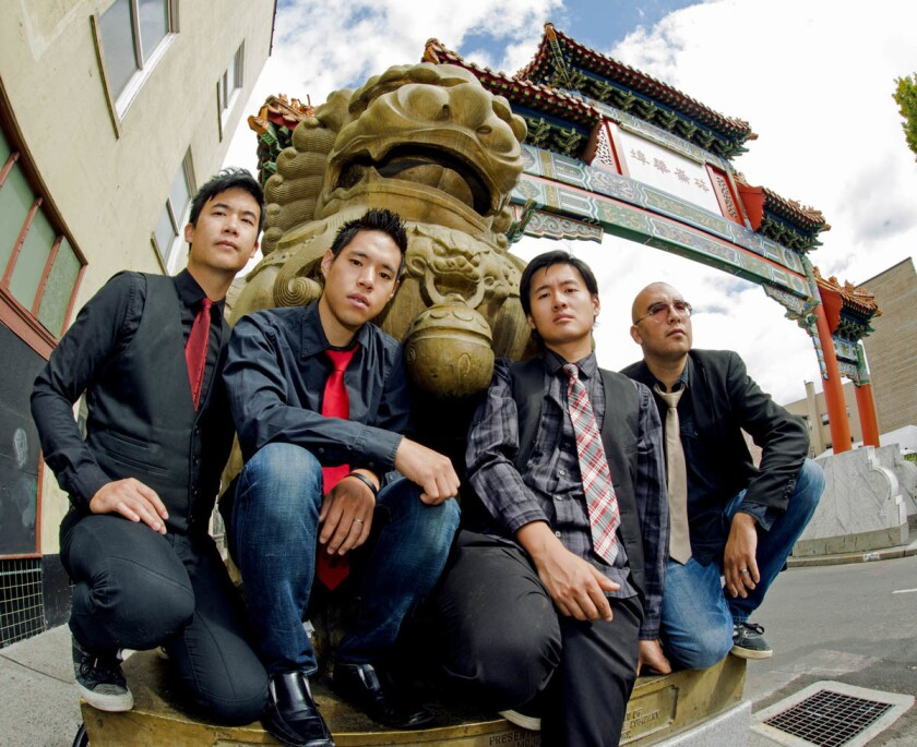 Asian-American band The Slants, with, from left Simon 'Young' Tam, Ken Shima, Joe X Jiang, Tyler Chen, at the Old Town Chin. (Anthony Pidgeon/Redferns)