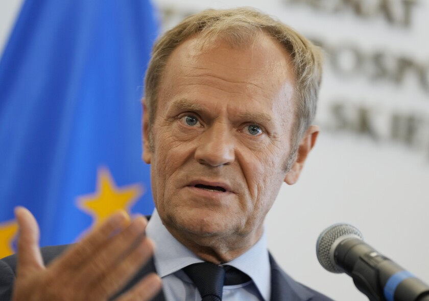 Former European Union head and Poland's ex-prime minister Donald Tusk speaks to journalists following his meeting with a political ally, Senate Speaker Tomasz Grodzki, at the Senate building, in Warsaw, Poland, on Tuesday, July 6, 2021. Tusk recently took leadership of the opposition, vowing to fight the current right-wing government. (AP Photo/Czarek Sokolowski)