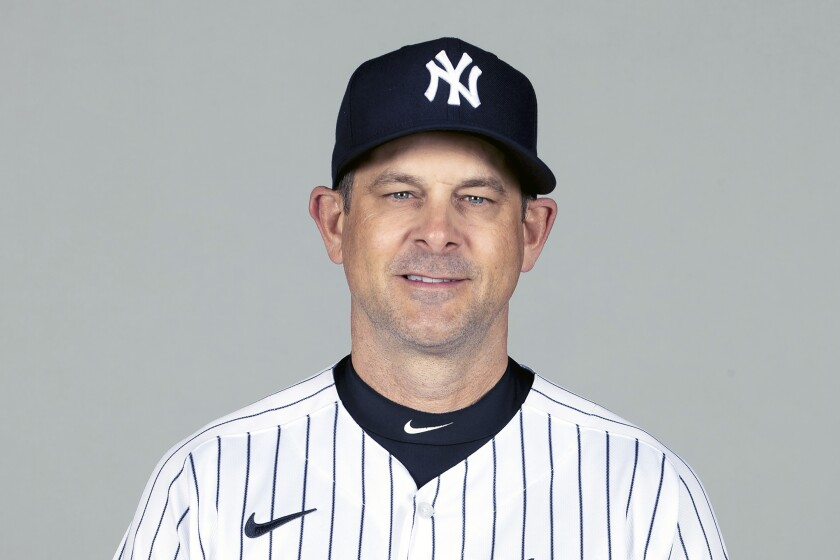 FILE - This is a Feb. 24, 2021, photo showing Aaron Boone of the New York Yankees baseball team. The New York Yankees announced Wednesday, March 3, 2021, that manager Aaron Boone is taking an immediate medical leave of absence to receive a pacemaker. (Mike Carlson/MLB Photos via AP, Pool)