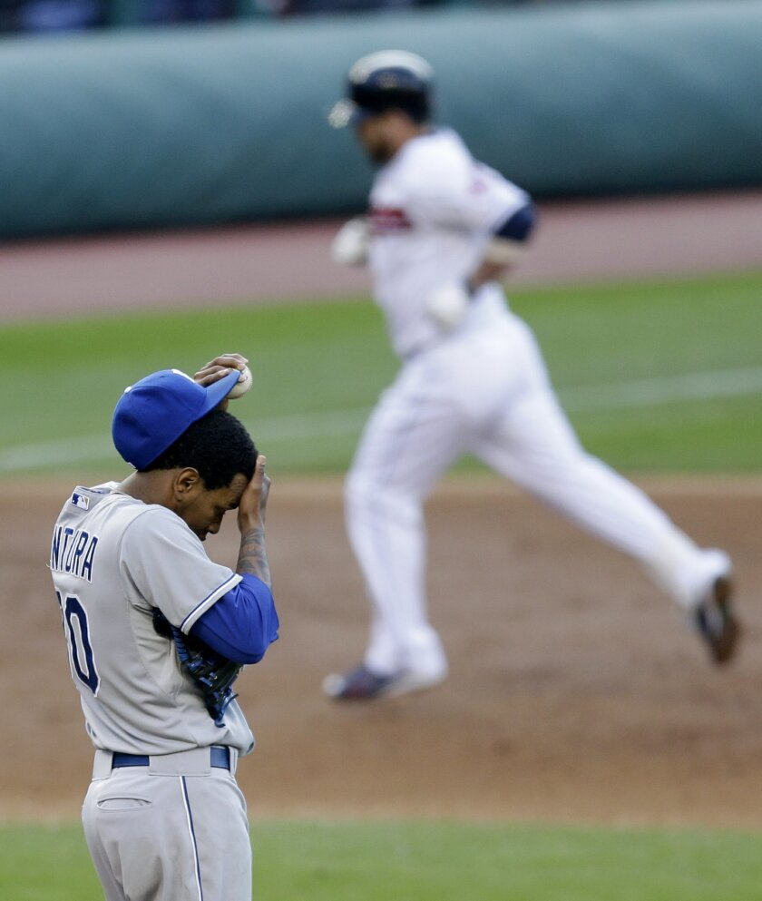 Kansas City Royals starting pitcher Yordano Ventura, left, waits for Cleveland Indians' Jason Kipnis, back, to run the bases after Kipnis hit a three-run home run in the third inning of a baseball game, Wednesday, April 29, 2015, in Cleveland. Roberto Perez and Michael Bourn scored on the play. (AP